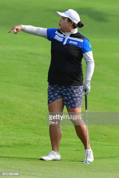 Shanshan Feng of China plays a shot on the 18th hole during the final round of the Blue Bay LPGA at Jian Lake Blue Bay golf course on November 11...