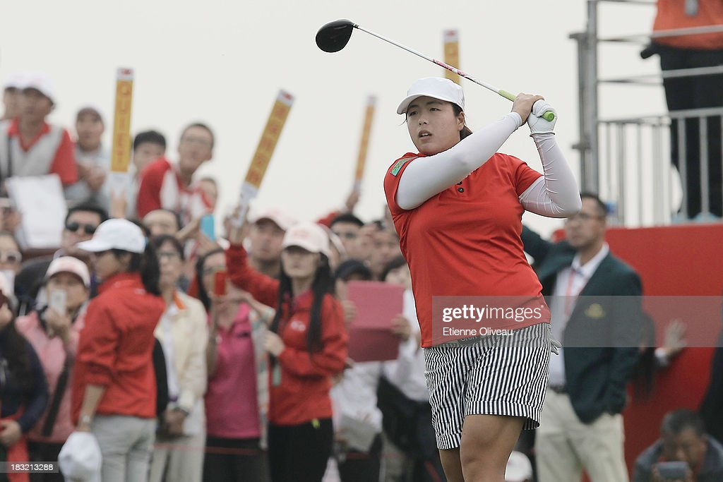 <a gi-track='captionPersonalityLinkClicked' href=/galleries/search?phrase=Shanshan+Feng&family=editorial&specificpeople=4682908 ng-click='$event.stopPropagation()'>Shanshan Feng</a> of China plays a tee shot during the final round of the Reignwood LPGA Classic at Pine Valley Golf Club on October 6, 2013 in Beijing, China.