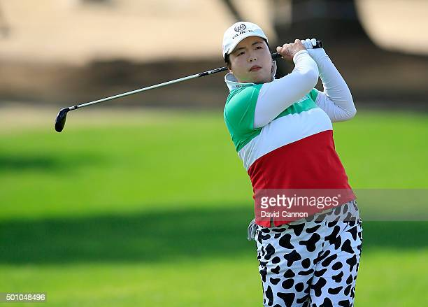 Shanshan Feng of China plays her second shot on the par 4 first hole during the final round of the 2015 Omega Dubai Ladies Masters on the Majlis...