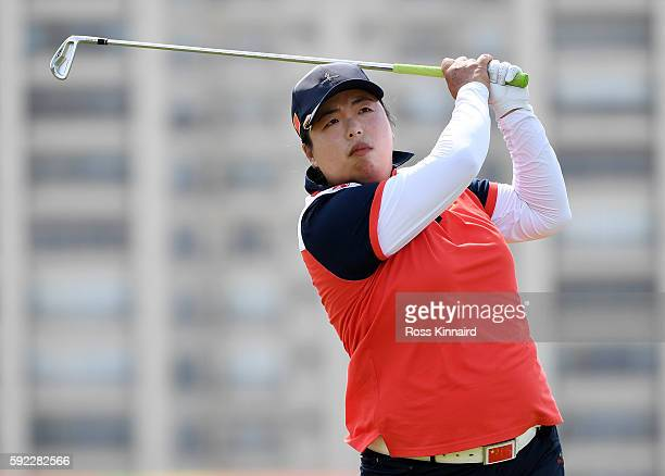 Shanshan Feng of China plays her shot from the eighth tee during the Women's Golf Final on Day 15 of the Rio 2016 Olympic Games at the Olympic Golf...