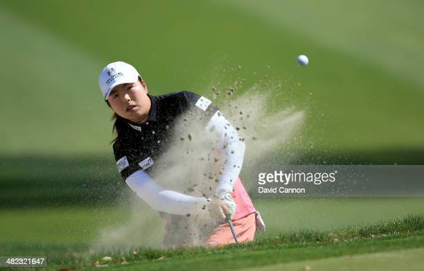Shanshan Feng of China plays her third shot at the par 5 11th hole during the first round of the 2014 Kraft Nabisco Championship on the Dinah Shore...
