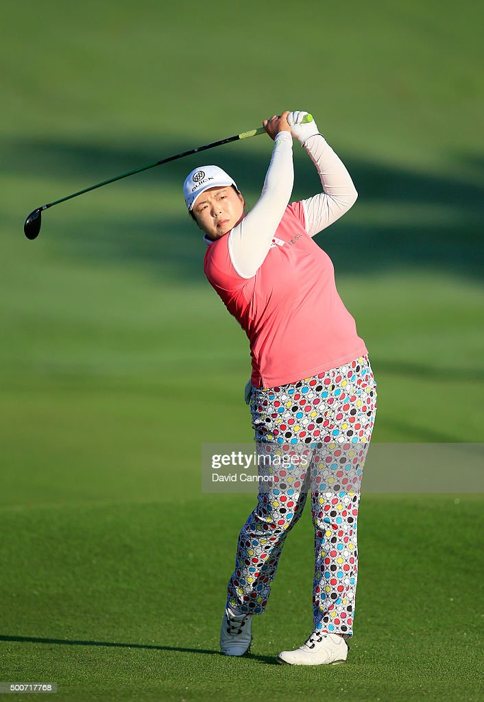 Shanshan Feng of China plays her third shot on the par 5 10th hole during the second round of the 2015 Omega Dubai Ladies Masters on the Majlis...
