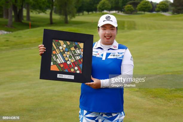 Shanshan Feng of China poses with the championship trophy after winning the LPGA Volvik Championship on May 28 2017 at Travis Pointe Country Club Ann...