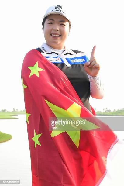 Shanshan Feng of China poses with the Chinese flag during a photo shoot after winning The Blue Bay LPGA on November 13 2017 in Hainan Island China...