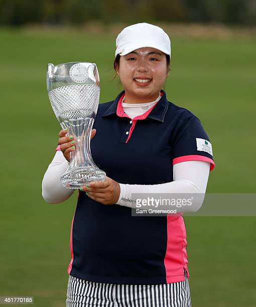 Shanshan Feng of China poses with the trophy after winning the CME Group Titleholders at Tiburon Golf club on November 24 2013 in Naples Florida
