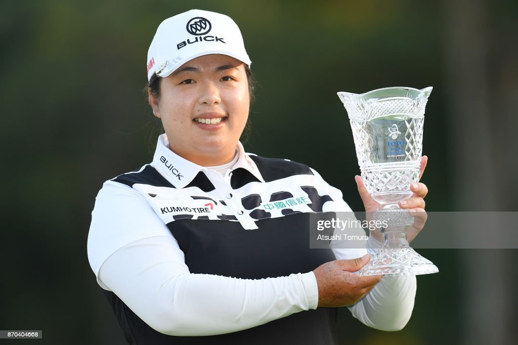 Shanshan Feng of China poses with the trophy after winning the TOTO Japan Classics 2017 at the Taiheiyo Club Minori Course on November 5, 2017 in Omitama, Ibaraki, Japan.