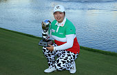 Shanshan Feng of China proudly holds the trophy after her victory in the final round of the 2015 Omega Dubai Ladies Masters on the Majlis Course at...