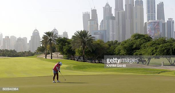 Shanshan Feng of China puts during the third round of the Dubai Ladies Masters in Dubai on December 11 2015 AFP PHOTO / KARIM SAHIB / AFP / KARIM...
