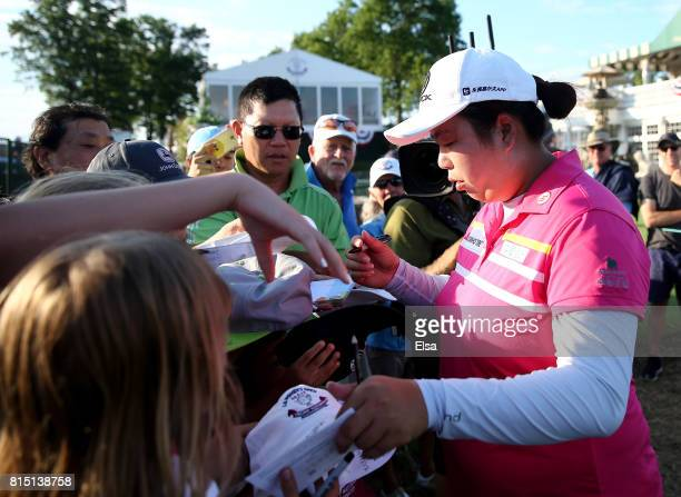 Shanshan Feng of China signs autographs as she heads off the 18th green during the US Women's Open round three on July 15 2017 at Trump National Golf...