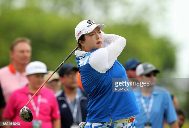 Shanshan Feng of China tees off on the 17th tee during the final round of the LPGA Volvik Championship at Travis Pointe Country Club Ann Arbor MI USA...