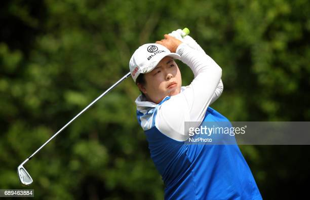 Shanshan Feng of China tees off on the 7th tee during the final round of the LPGA Volvik Championship at Travis Pointe Country Club Ann Arbor MI USA...