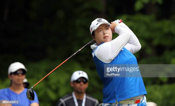 Shanshan Feng of China tees off on the 8th tee during the final round of the LPGA Volvik Championship at Travis Pointe Country Club Ann Arbor MI USA...