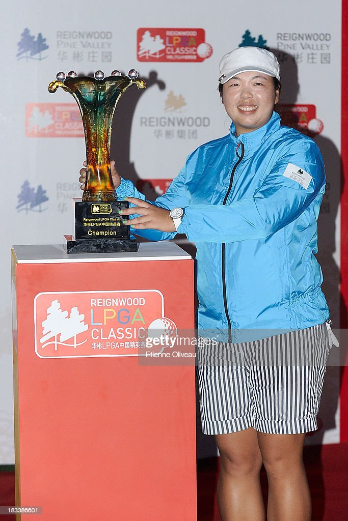 <a gi-track='captionPersonalityLinkClicked' href=/galleries/search?phrase=Shanshan+Feng&family=editorial&specificpeople=4682908 ng-click='$event.stopPropagation()'>Shanshan Feng</a> poses next to her trophy during the closing ceremony of the Reignwood LPGA Classic at Pine Valley Golf Club on October 6, 2013 in Beijing, China.