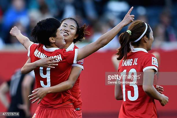 Shanshan Wang of China PR celebrates as she scores their second goal during the FIFA Women's World Cup Canada 2015 Group A match between China PR and...