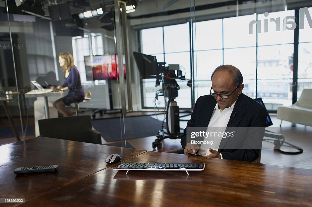 Shantanu Narayen, president and chief executive officer of Adobe Systems Inc., checks his smartphone before a Bloomberg West television interview in San Francisco, California, U.S., on Wednesday, May 8, 2013. Narayen says Adobe Systems Inc. will focus Creative software development efforts on Creative Cloud and has no plans for future releases of Creative Suite or other CS products. Photographer: David Paul Morris/Bloomberg via Getty Images