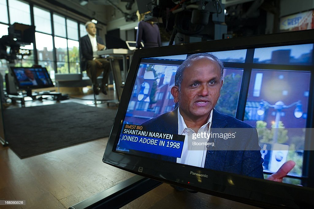 Shantanu Narayen, president and chief executive officer of Adobe Systems Inc., is seen on a monitor while speaking during a Bloomberg West television interview in San Francisco, California, U.S., on Wednesday, May 8, 2013. Narayen says Adobe Systems Inc. will focus Creative software development efforts on Creative Cloud and has no plans for future releases of Creative Suite or other CS products. Photographer: David Paul Morris/Bloomberg via Getty Images