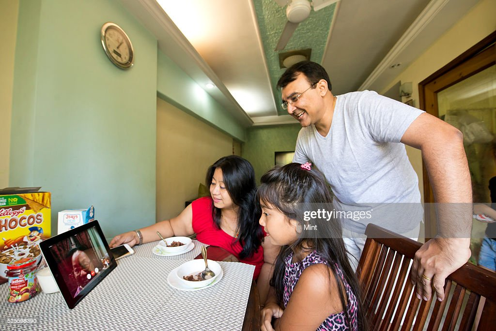 Shantanu, Sophia and their daughter Teesta using Skype and Facetime to communicate with other family members on May 23, 2015 in Mumbai, India.