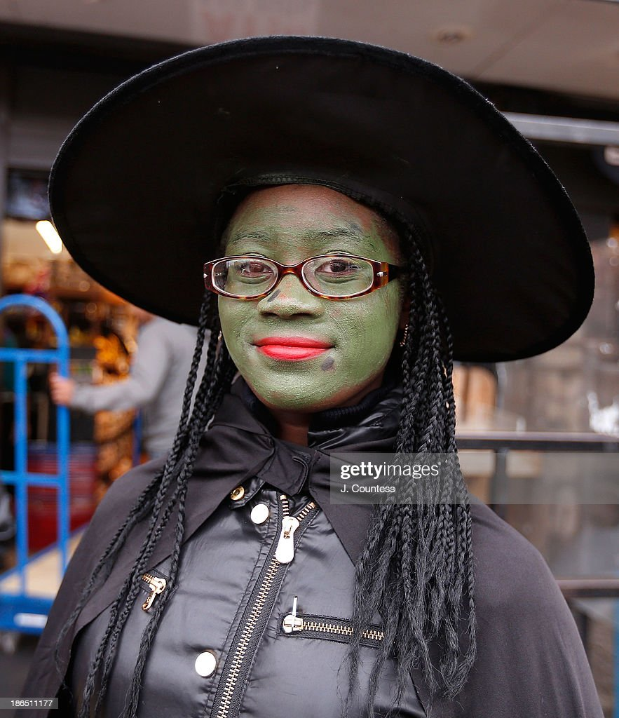 'Shantee' of BedfordÐStuyvesant poses for a photo as she 'Trick or Treats' in BedfordÐStuyvesant, Brooklyn on October 31, 2013 in New York City.