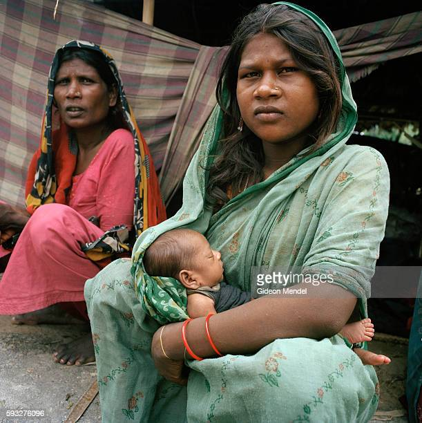 Shanti Devi with her twelvedayold daughter which she had given birth to at the peak of recent flooding She is with her neighbour Suganti Devi in...