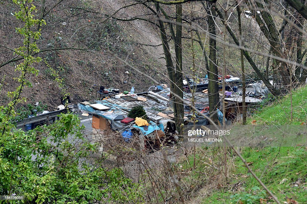 Shanty houses are seen roadside on the periphery of Paris on December 26, 2012. AFP PHOTO / Miguel Medina