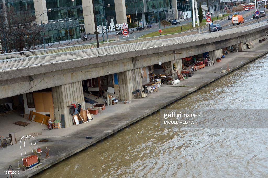 Shanty houses are seen under a bridge in Paris on December 26, 2012. AFP PHOTO / Miguel Medina