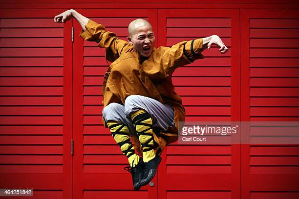 Shaolin monk poses for a photograph in Chinatown on February 23 2015 in London England The monks practice Shaolin Kung Fu which is believed to be the...