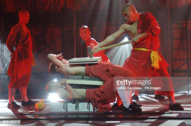Shaolin Monks perform their new show 'Kung Fu Masters Live' at the Peacock Theatre in London Wednesday October 19 2005 demonstrating their feats of...
