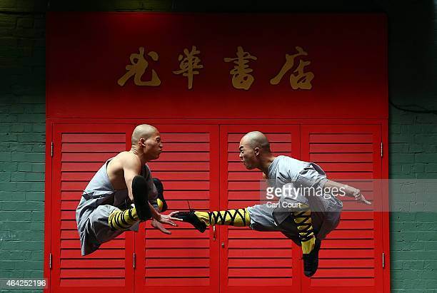 Shaolin monks pose for a photograph in Chinatown on February 23 2015 in London England The monks practice Shaolin Kung Fu which is believed to be the...