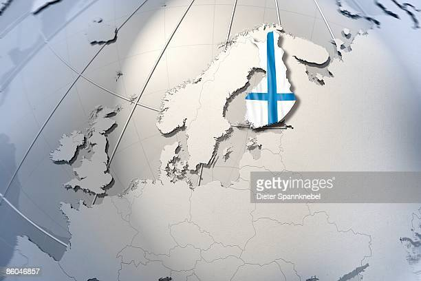 Shape and ensign of Finland on a globe