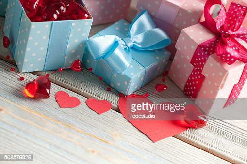 Shape of hearts and colored gift boxes : Stock Photo