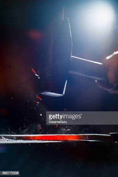 Shaping Glowing Knife Blade with a Hammer Close Up
