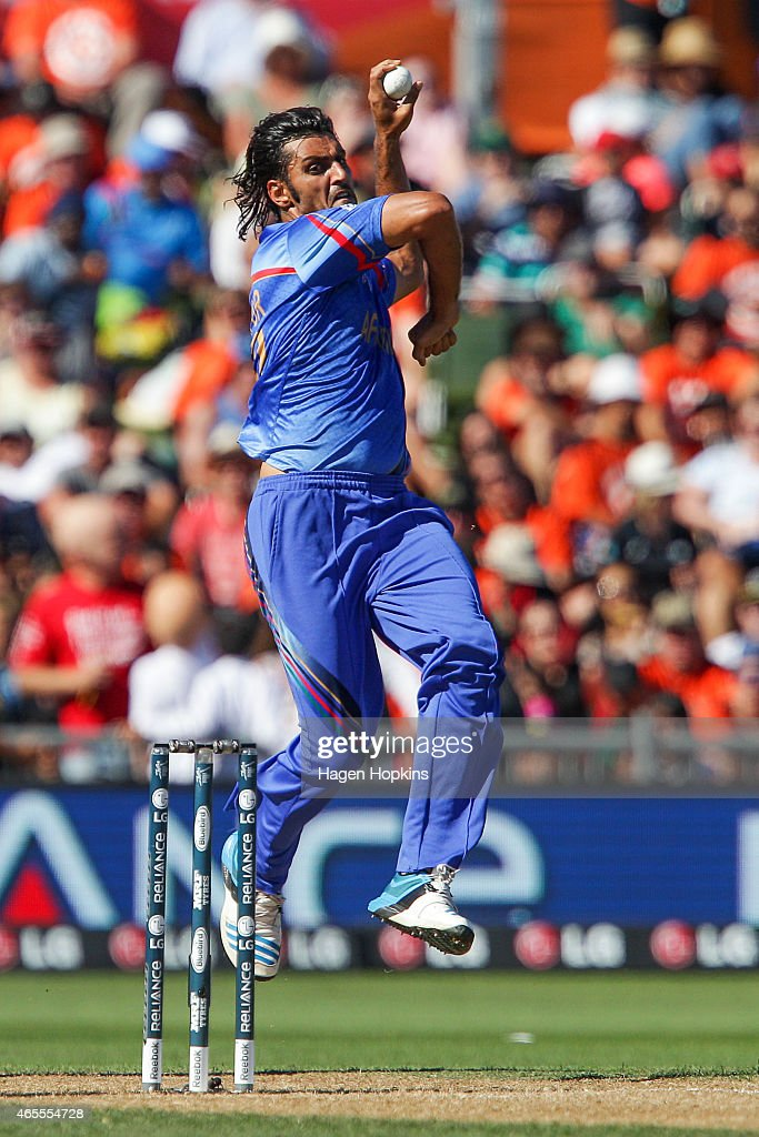 <a gi-track='captionPersonalityLinkClicked' href=/galleries/search?phrase=Shapoor+Zadran&family=editorial&specificpeople=6217332 ng-click='$event.stopPropagation()'>Shapoor Zadran</a> of Afghanistan bowls during the 2015 ICC Cricket World Cup match between New Zealand and Afghanistan at McLean Park on March 8, 2015 in Napier, New Zealand.