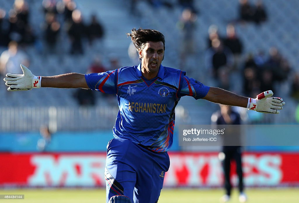 <a gi-track='captionPersonalityLinkClicked' href=/galleries/search?phrase=Shapoor+Zadran&family=editorial&specificpeople=6217332 ng-click='$event.stopPropagation()'>Shapoor Zadran</a> of Afghanistan celebrates hitting the winning runs in Afghanistan's win over Scotland during the 2015 ICC Cricket World Cup match between Afghanistan and Scotland at University Oval on February 26, 2015 in Dunedin, New Zealand.