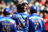 Shapoor Zadran of Afghanistan celebrates with team mates during the 2015 ICC Cricket World Cup match between Afghanistan and Scotland at University...