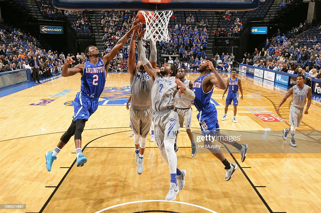 Shaq Goodwin of the Memphis Tigers and Kennedy Eubanks of the TexasArlington Mavericks jump for a rebound on November 23 2015 at FedExForum in...