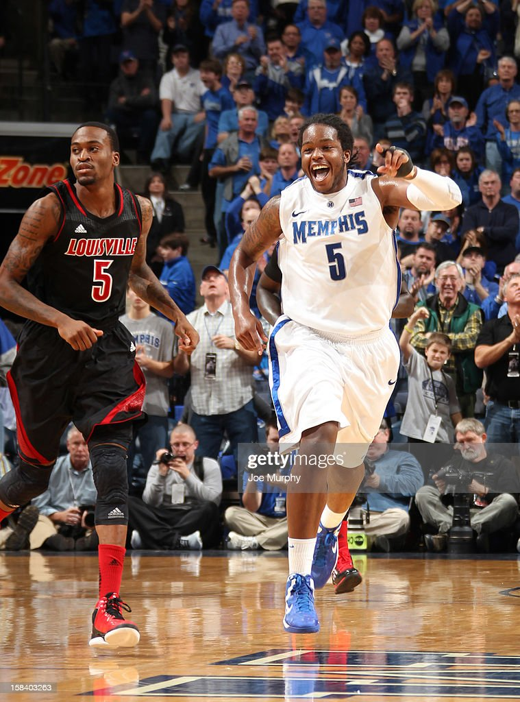 Shaq Goodwin #5 of the Memphis Tigers celebrates a play against Kevin Ware #5 of the Louisville Cardinals on December 15, 2012 at FedExForum in Memphis, Tennessee.