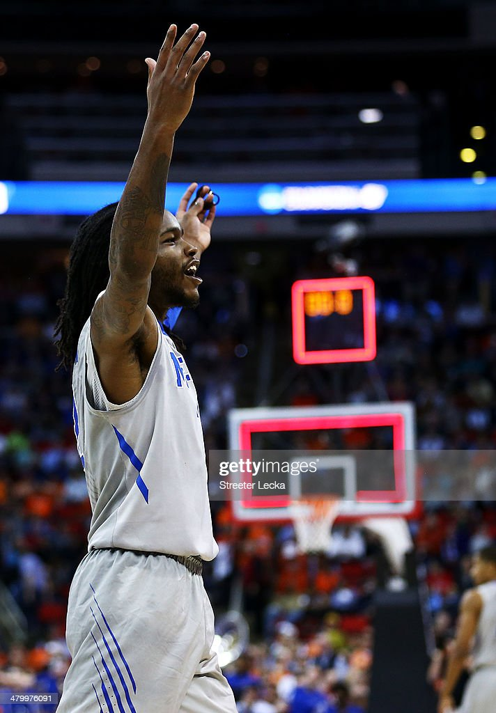 Shaq Goodwin of the Memphis Tigers celebrates their 71 to 66 win over the George Washington Colonials during the Second Round of the 2014 NCAA...