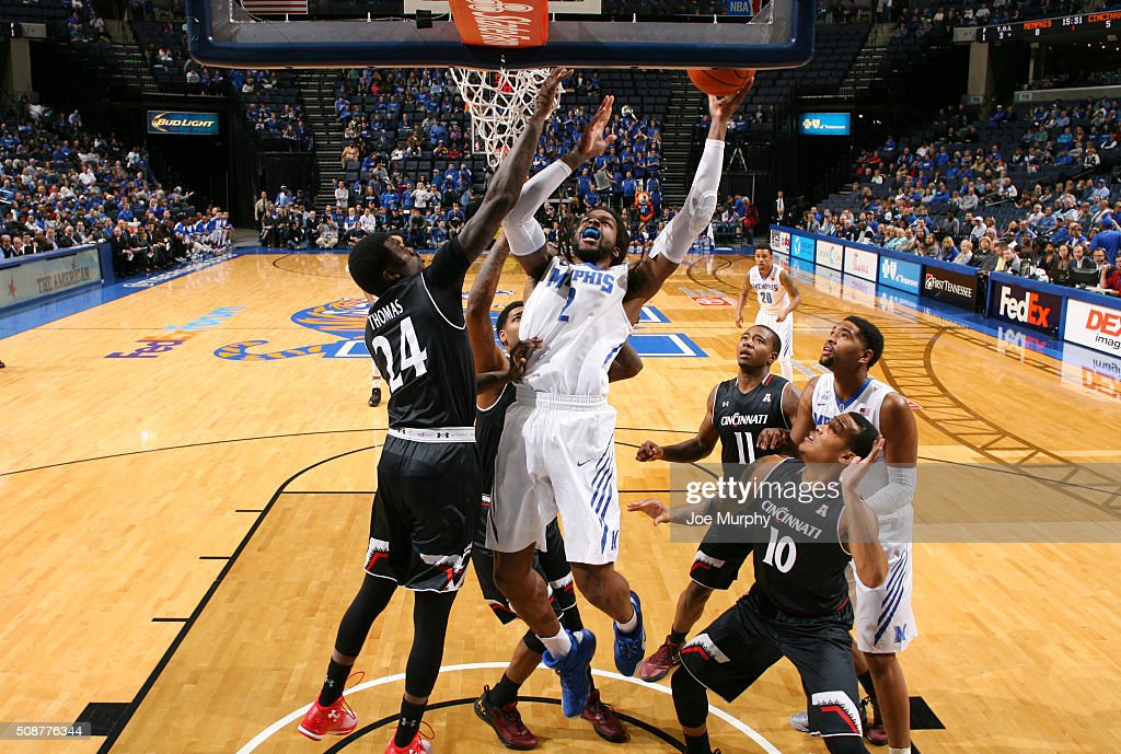 Shaq Goodwin #2 of the Memphis Tigers drives to the basket for a layup against Shaq Thomas #24 of the Cincinnati Bearcats on February 6, 2016 at FedExForum in Memphis. Memphis defeated Cincinnati 63-59.
