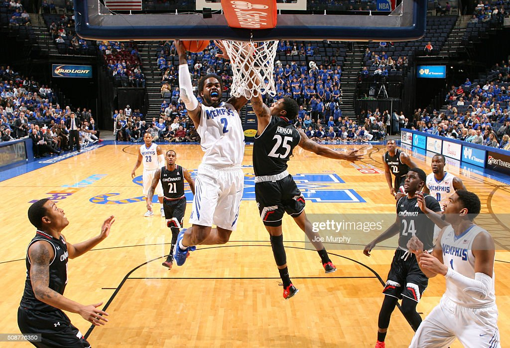 Shaq Goodwin #2 of the Memphis Tigers drives to the basket for a layup against Kevin Johsnon #25 of the Cincinnati Bearcats on February 6, 2016 at FedExForum in Memphis. Memphis defeated Cincinnati 63-59.