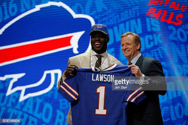 Shaq Lawson of Clemson holds up a jersey with NFL Commissioner Roger Goodell after being picked overall by the Buffalo Bills during the first round...