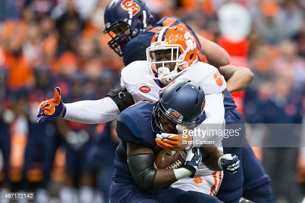 Shaq Lawson of the Clemson Tigers tackles Jordan Fredericks of the Syracuse Orange during the first half on November 14 2015 at The Carrier Dome in...