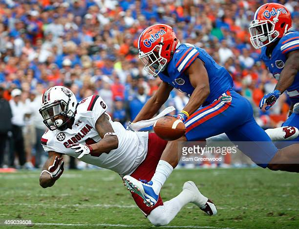 Shaq Roland of the South Carolina Gamecocks attempts to make a reception against Vernon Hargreaves of the Florida Gators during the game at Ben Hill...