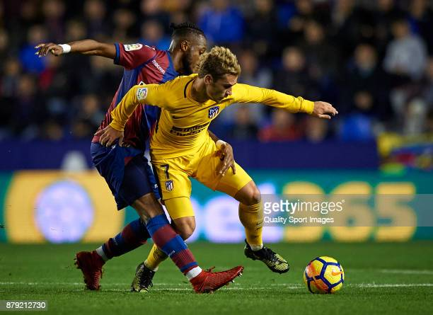 Shaquell Moore of Levante competes for the ball with Antoine Griezmann of Atletico Madrid during the La Liga match between Levante and Atletico...
