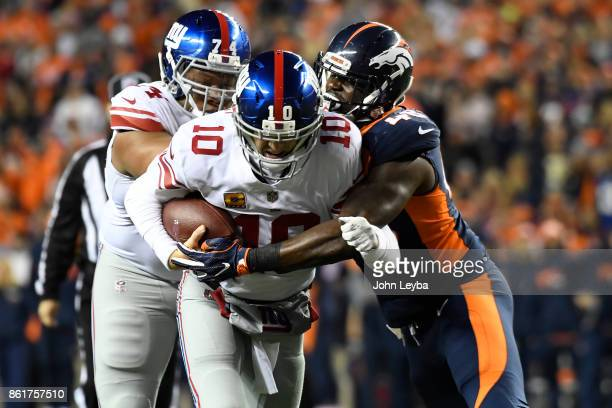 Shaquil Barrett of the Denver Broncos sacks Eli Manning of the New York Giants in the first quarter The Denver Broncos hosted the New York Giants at...