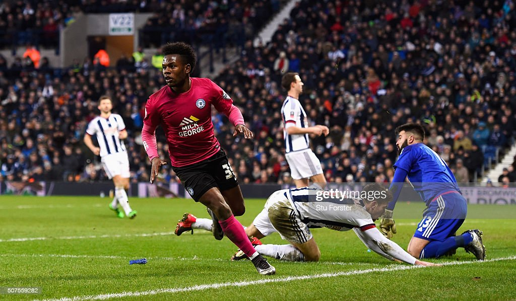 Shaquile Coulthirst of Peterborough United celebrates scoring his team's first goal during the Emirates FA Cup Fourth Round match between West Bromwich Albion and Peterborough United at The Hawthorns on January 30, 2016 in West Bromwich, England.