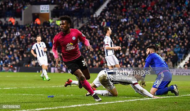 Shaquile Coulthirst of Peterborough United celebrates scoring his team's first goal during the Emirates FA Cup Fourth Round match between West...