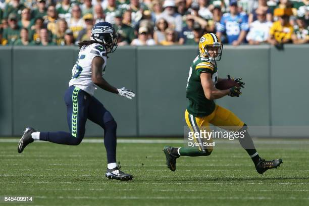 Shaquill Griffin of the Seattle Seahawks pursues Jordy Nelson of the Green Bay Packers during the first half at Lambeau Field on September 10 2017 in...