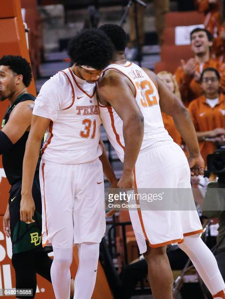 Shaquille Cleare and Jarrett Allen of the Texas Longhorns chest bump after Jarrett Allen slam dunked against the Baylor Bears at the Frank Erwin...