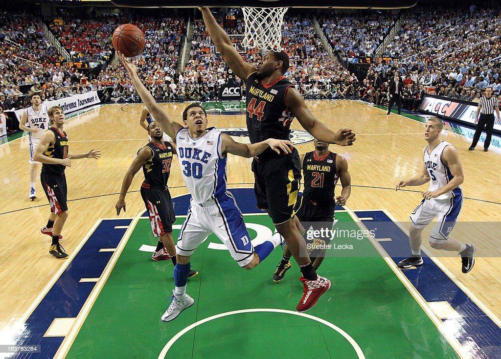 Shaquille Cleare #44 of the Maryland Terrapins tries to stop Seth Curry #30 of the Duke Blue Devils during the quarterfinals of the Men's ACC Basketball Tournament at Greensboro Coliseum on March 15, 2013 in Greensboro, North Carolina.