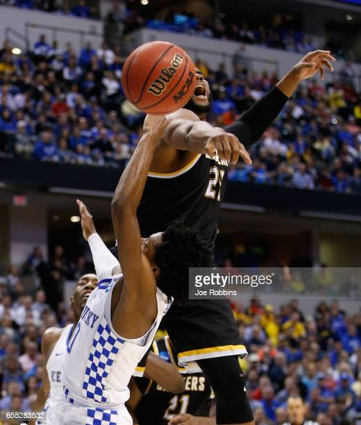 Shaquille Morris of the Wichita State Shockers blocks a shot by De'Aaron Fox of the Kentucky Wildcats in the first half during the second round of...